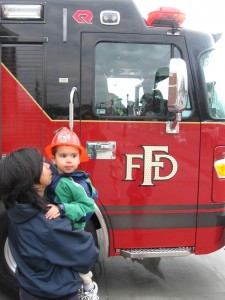 Joseph became scared of the fire trucks after one of them had to leave on a call. He didn't want to have his photo taken with the other truck.