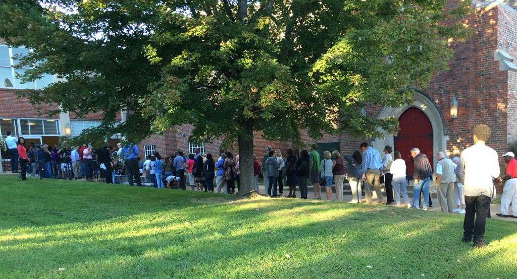 Ferguson residents line up outside Wellspring Church waiting to attend the first DOJ town hall meeting.