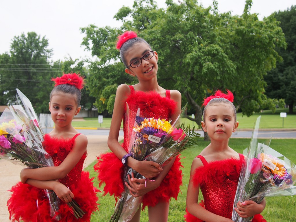 Ludi, Jadzia, and Josie show off their flowers and their dresses after the first dance recital