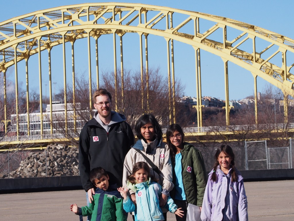 Family photo in front of a bridge in Pittsburgh