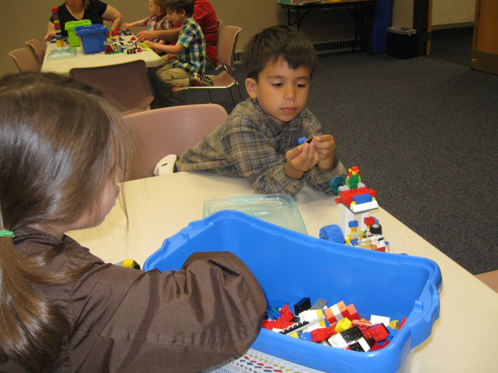 Joseph and Josie build creations at Lego club at Prairie Commons.