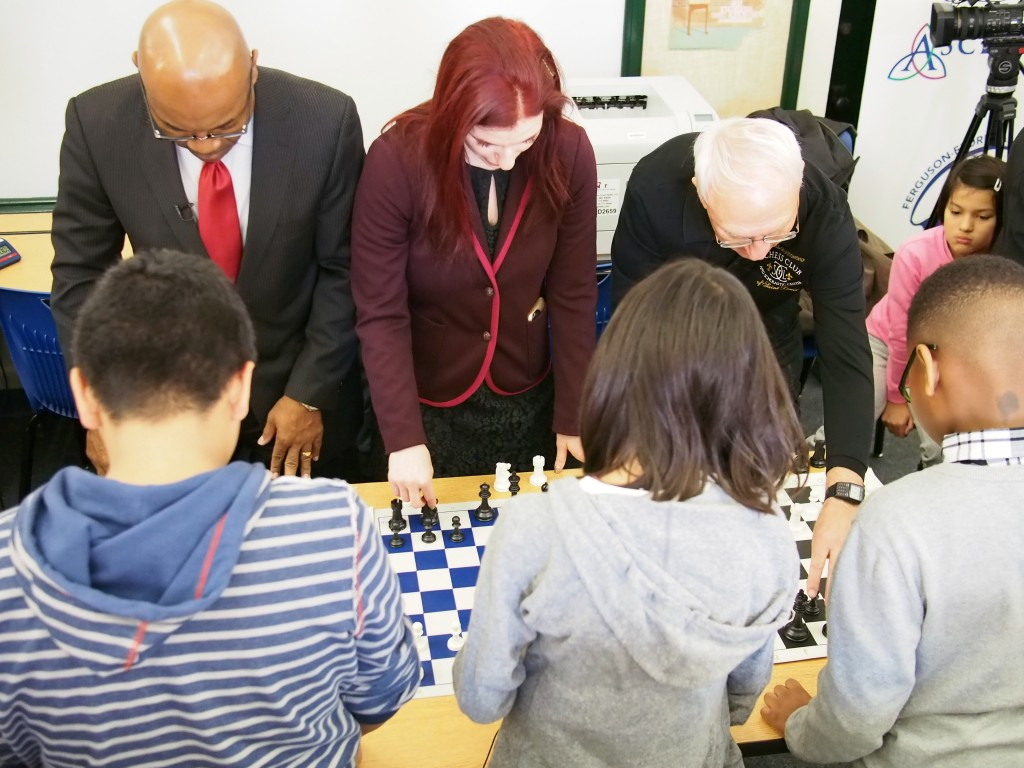 Jadzia plays chess against grandmaster Jennifer Shahade